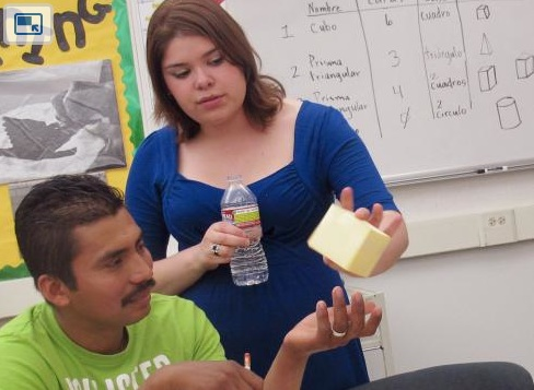 ... demonstrates a cube in Fresno's Adult School in a Spanish math class.