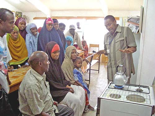 Incoming Somali refugees learn the fine points of operating a modern stove.