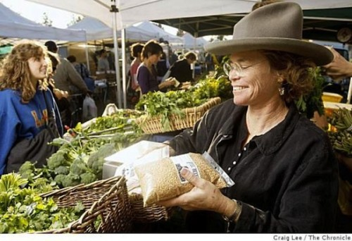 Judith Redmond, a farmer at Full Belly Farm, selling her wheat berries and vegetables at the farmers market in Berkeley, California.