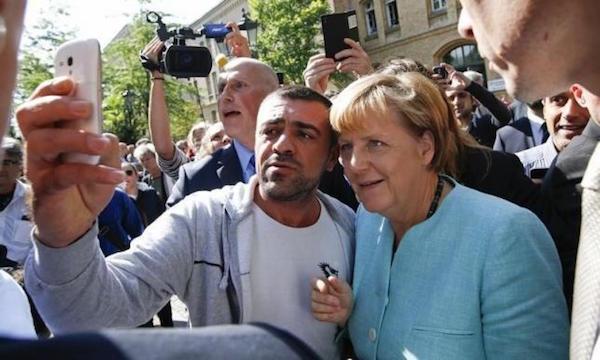 GermanyMerkelSelfieMigrant