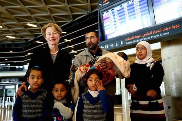 AmbassadorHerdsSyriansInAirportToMissouri